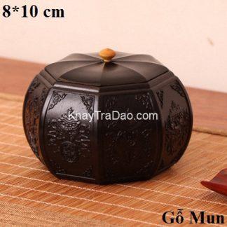 lọ đựng trà gỗ mun dáng lục phương tròn chạm khắc nổi thủ công đẹp ht13