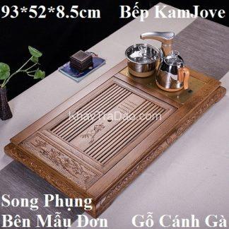 bàn trà điện kamjove gỗ cánh gà chạm khắc song phụng mẫu đơn kèm bếp đun nước tự động