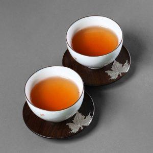 Lót ly trà gỗ gụ hình tròn đính bạc dùng để kê tách chén trà đẹp