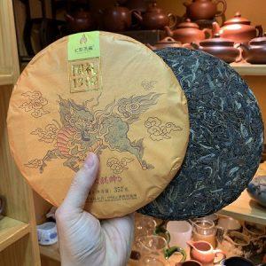 Trà phổ nhĩ sống cao cấp Vân Nam Kỳ Lân bánh tròn 357g Năm 2019 cốt trà tuyển chọn